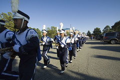musician(0.0), police(0.0), demonstration(0.0), military(0.0), air force(0.0), marching band(1.0), musical ensemble(1.0), marching(1.0), person(1.0), troop(1.0),
