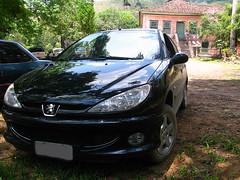coupã©(0.0), automobile(1.0), automotive exterior(1.0), peugeot(1.0), family car(1.0), wheel(1.0), vehicle(1.0), automotive design(1.0), subcompact car(1.0), peugeot 206(1.0), bumper(1.0), land vehicle(1.0),
