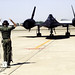 A ground crewman marshalls an SR-71 Blackbird being piloted by Undersecretary of the Air Force Edward C. Aldrich, into its parking position after a flight. (U.S. Air Force photo/Paul N. Hayashi)