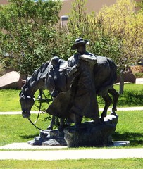 cowboy statue in front of abq museum
