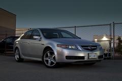 automobile(1.0), automotive exterior(1.0), executive car(1.0), wheel(1.0), vehicle(1.0), rim(1.0), full-size car(1.0), compact car(1.0), bumper(1.0), acura tl(1.0), sedan(1.0), land vehicle(1.0), luxury vehicle(1.0), acura(1.0),