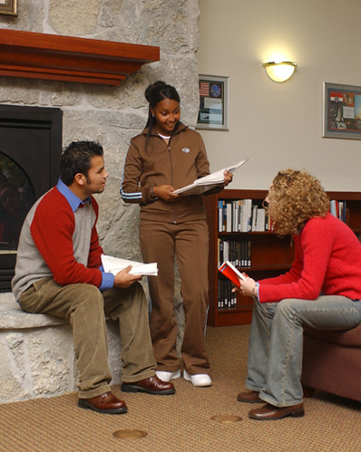 Students studying in the library lobby