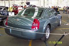 automobile(1.0), automotive exterior(1.0), wheel(1.0), vehicle(1.0), chrysler 300(1.0), compact car(1.0), chrysler(1.0), bumper(1.0), sedan(1.0), land vehicle(1.0), luxury vehicle(1.0),
