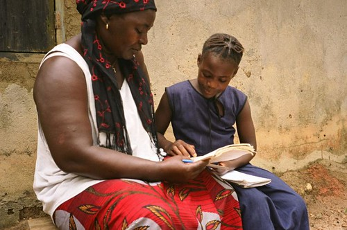 Woman and girl reading