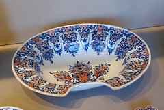 blue and white porcelain(0.0), bowl(0.0), art(1.0), dishware(1.0), platter(1.0), tableware(1.0), saucer(1.0), ceramic(1.0), porcelain(1.0),