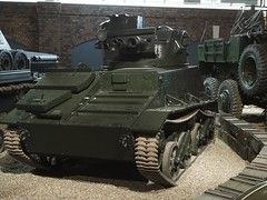 churchill tank(0.0), m113 armored personnel carrier(0.0), armored car(1.0), army(1.0), combat vehicle(1.0), military vehicle(1.0), weapon(1.0), vehicle(1.0), tank(1.0), self-propelled artillery(1.0), gun turret(1.0), land vehicle(1.0), military(1.0),
