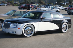 rolls-royce phantom(0.0), auto show(0.0), automobile(1.0), automotive exterior(1.0), wheel(1.0), vehicle(1.0), performance car(1.0), automotive design(1.0), rim(1.0), chrysler 300(1.0), chrysler(1.0), sedan(1.0), land vehicle(1.0), luxury vehicle(1.0), motor vehicle(1.0),