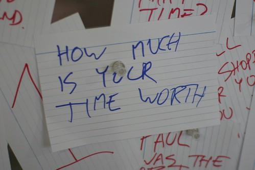 "Note card with handwritten ""How much is your time worth"""