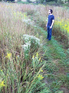Tall man in the tall grass prairie