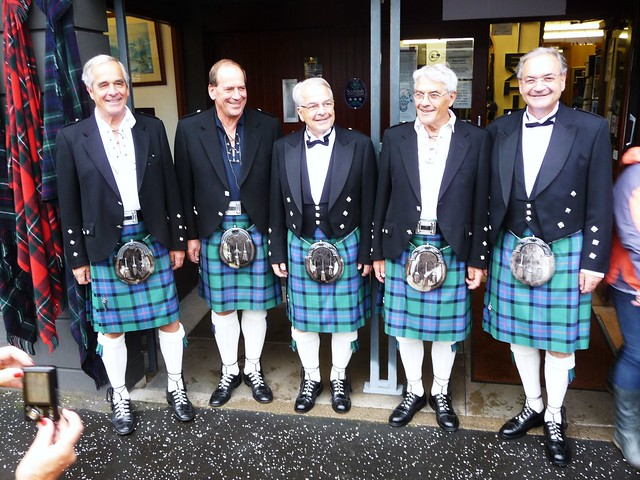 Tour guests wearing kilts in Inverness, Scottish Highlands