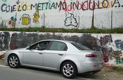 sports car(0.0), automobile(1.0), automotive exterior(1.0), alfa romeo(1.0), executive car(1.0), family car(1.0), wheel(1.0), vehicle(1.0), automotive design(1.0), alfa romeo 159(1.0), full-size car(1.0), compact car(1.0), bumper(1.0), sedan(1.0), land vehicle(1.0), luxury vehicle(1.0),