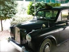 morris minor(0.0), compact car(0.0), automobile(1.0), automotive exterior(1.0), vehicle(1.0), austin fx4(1.0), antique car(1.0), classic car(1.0), vintage car(1.0), land vehicle(1.0), luxury vehicle(1.0),