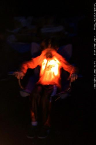 nick, illuminating his shirt with his headlamp