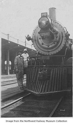 George and Melrine Longworth with Northern Pacific locomotive #241, Seattle, ca. 1914