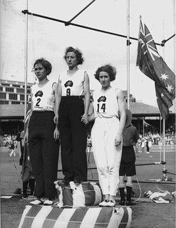 Decima Norman, Jean Coleman and Eileen Wearne win gold, silver and bronze medals for Australia in the 220 yard sprint, Empire Games, Sydney, 11 February 1938 / photographer Sam Hood