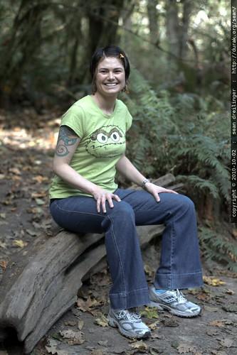 rachel, sitting on a log