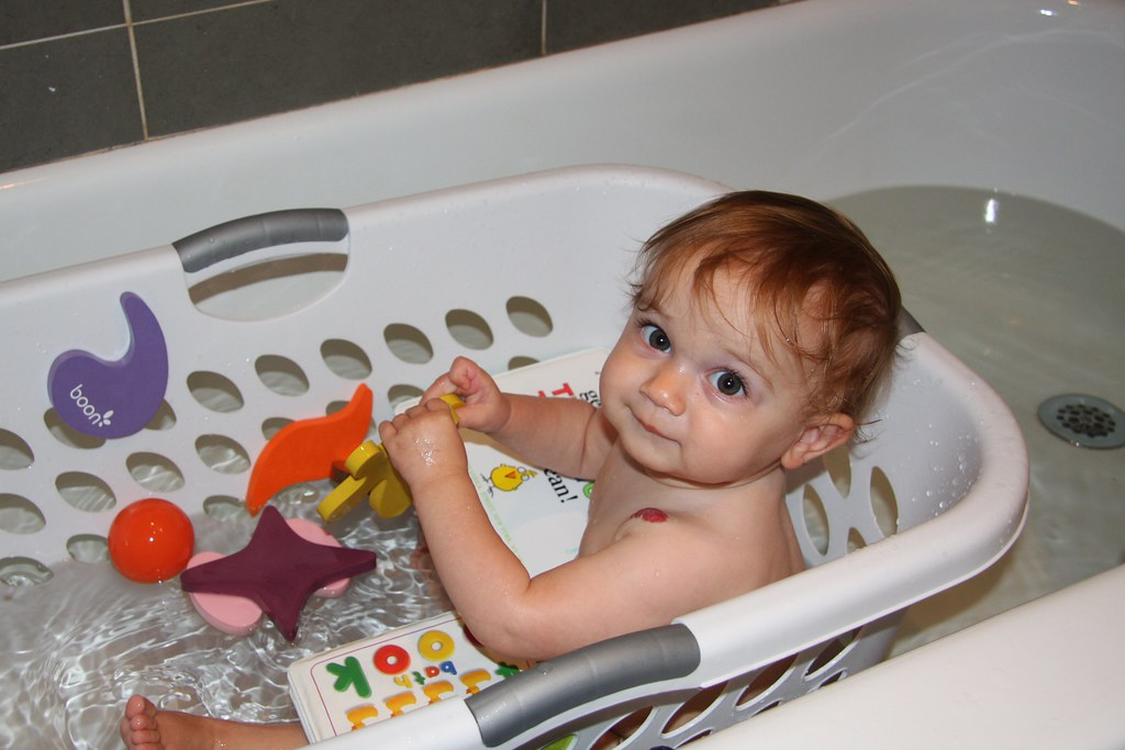 I love bathing in the laundry basket!