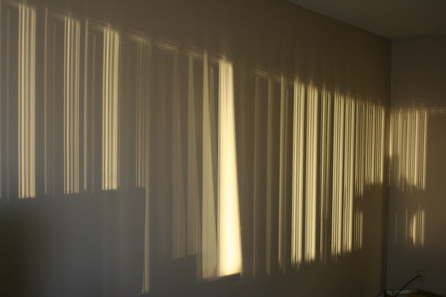 setting sun and vertical blinds