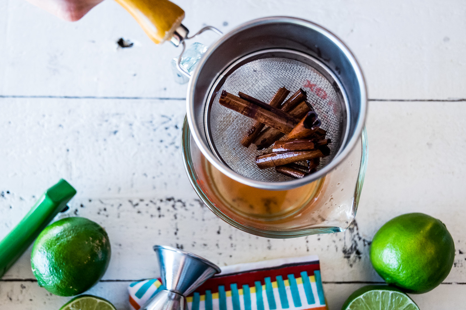 removing the sticks from the cinnamon simple syrup