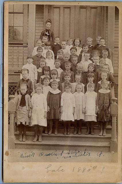 Children gather outside their school house