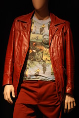 formal wear(0.0), spring(0.0), textile(1.0), leather jacket(1.0), clothing(1.0), sleeve(1.0), maroon(1.0), leather(1.0), outerwear(1.0), fashion(1.0), jacket(1.0),