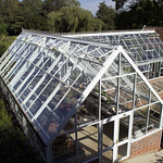 An L Shaped Free standing Hartley greenhouse