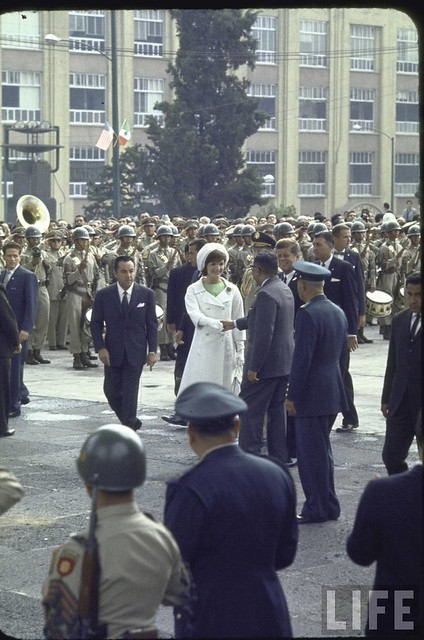 Pres. John F. Kennedy and his wife Jacqueline greeting officials during a state visit to Mexico. July 1962