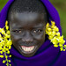 Surma smiling kid with flowers - Turgit Ethiopia
