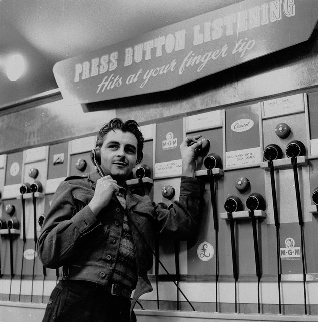hmv 363 Oxford Street, London - Customer using listening post 1950s