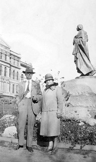 Two people in front of Sakakawea Statue and old North Dakota State Capitol Bismarck ND