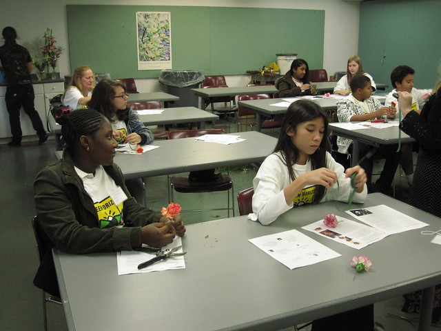 Green Horizon students try their hand at making boutonnieres as they learn about designing with flowers.