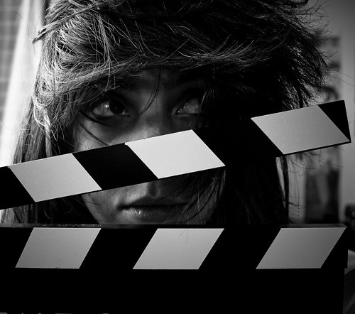 Girl posing with a movie clapperboard