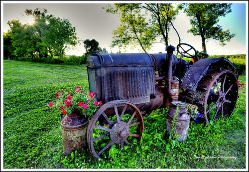 tractor antique rusty digital canon summer farm farmtractor canoneos canon6d outdoor farmfield wisconsin usa america northamerica midwest centralwisconsin marathoncounty marathoncountywisconsin mccormick mccormicktractor antiquetractor rural country hdr tonemapping photomatix geotagged milkcans petunias pastoral scenery scenic farmimplement ironwheels 1740l agriculture