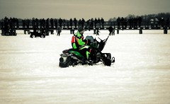 sled(0.0), auto racing(1.0), racing(1.0), winter sport(1.0), winter(1.0), vehicle(1.0), snow(1.0), motorsport(1.0), snowmobile(1.0),
