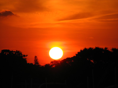 sunset sky orange sun water marina canon boat dock florida fl isles englewood