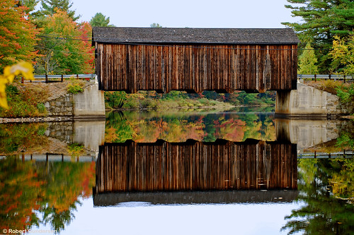 road street old bridge autumn red orange usa brown reflection building tree green fall water yellow river catchycolors landscape outside gold photo leaf interesting nikon flickr exterior image shots outdoor country picture newengland newhampshire engineering places whitemountains nh foliage infrastructure coveredbridge scenes gundersen livefreeordie nikoncamera nikond40x d40x bobgundersen robertgundersen