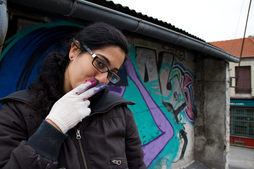 AM working on her mural on a rooftop in Paris (2010). Photo by Daniela Capistrano