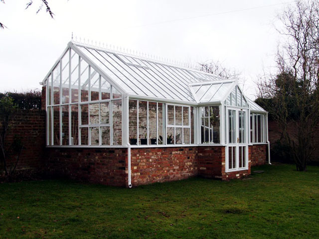 A Hartley Bespoke three quarter span lean-to glasshouse.