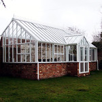 A Hartley Custom Made three quarter span lean-to greenhouse.
