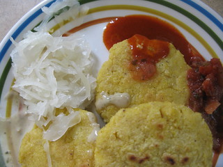 arepas with saurkraut, tapatio, and salsa