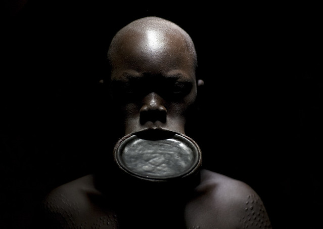 Shaved Surma woman with lip plate - Ethiopia