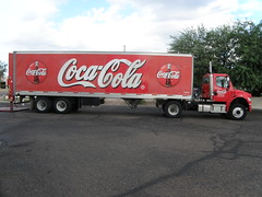 commercial vehicle(1.0), vehicle(1.0), truck(1.0), soft drink(1.0), carbonated soft drinks(1.0), drink(1.0), cola(1.0), coca-cola(1.0),