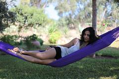 physical fitness(0.0), sitting(0.0), arm(1.0), leisure(1.0), limb(1.0), leg(1.0), photo shoot(1.0), hammock(1.0),