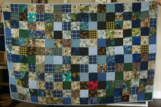 Misty and Kat were kind enough to hold up the quilt, so I could finally have a straightforward photo of the finished quilt. I kept this one; the fabrics have personal meaning to me. It's roughly twin-sized, and is used on the back of our love seat. Blog entry: domesticat.net/quilts/kissing-thief