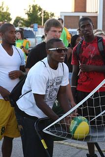 Students playing shooting basketball