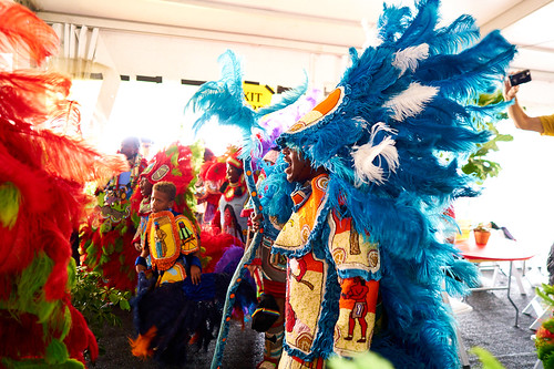 9th Ward Black Hatchets  Mardi Gras Indians in the 'OZ Hospitality Tent. Saturday, April 29, 2017 - Jazz Fest Day 2. Photo by Eli Mergel.