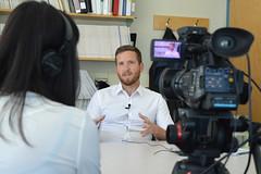 CARBC PhD student Adam Sherk being interviewed by Global News
