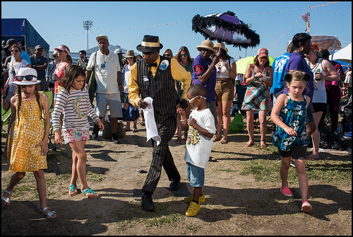 Nine Times SA & PC member teaches kids dancing during Original Pinttes at Jazz Fest day 6 on May 6, 2017. Photo by Ryan Hodgson-Rigsbee www.rhrphoto.com