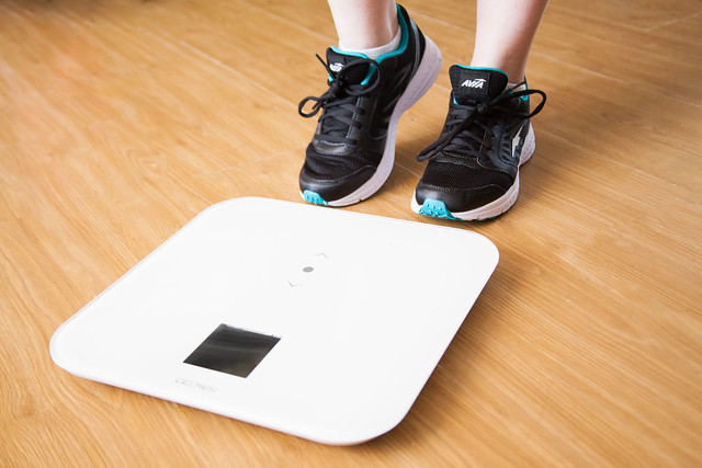 person about to stand on weighing digital scale