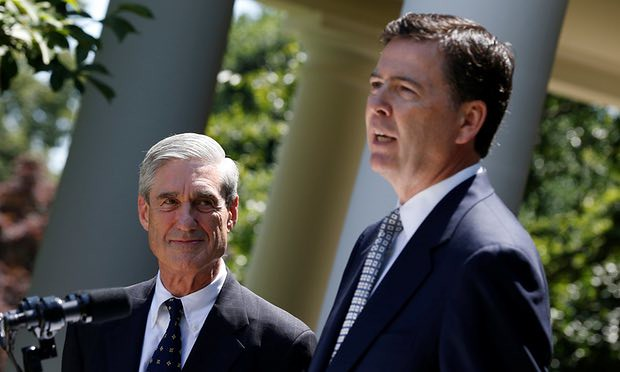 James Comey speaks alongside Robert Mueller at the White House in 2013. Photograph: Jason Reed/Reuters